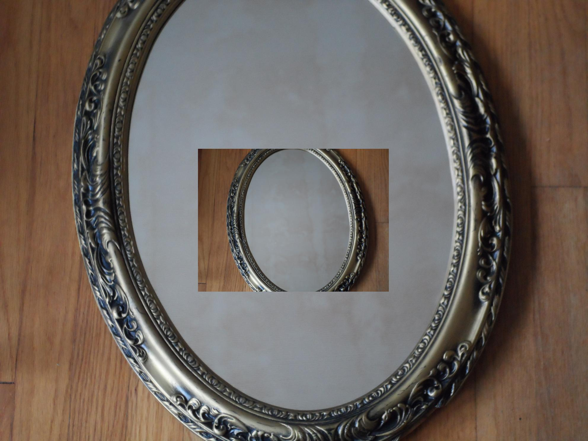 Picture of a tarnished silver frame on a wooden surface with the same image copied inside the frame, creating an image within an image.